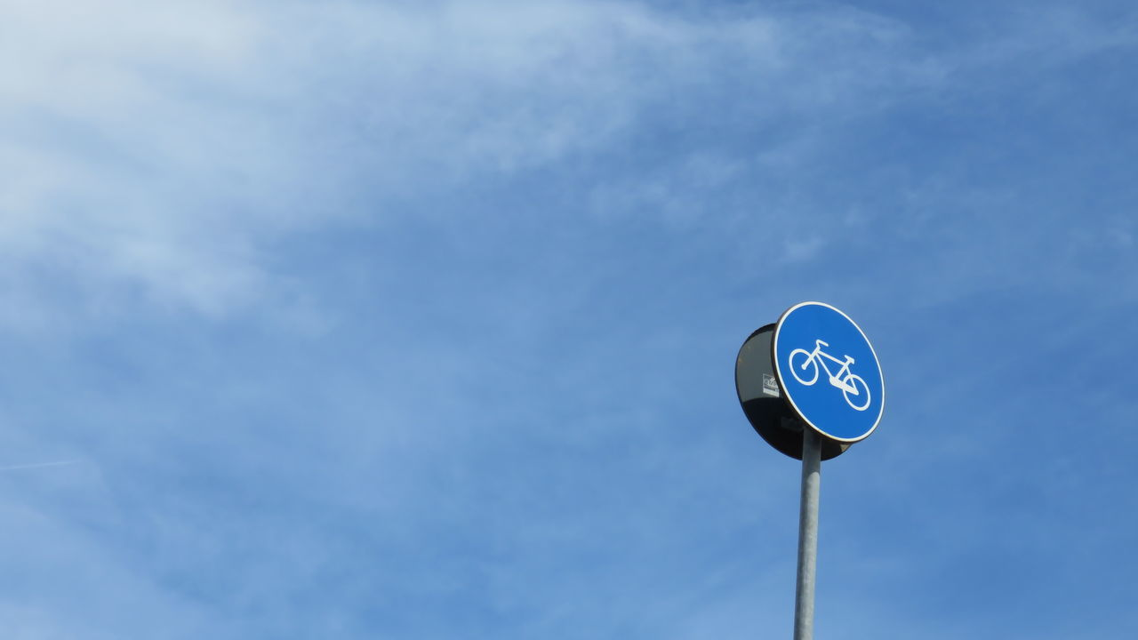 Low Angle View Of Bicycle Sign Against Sky