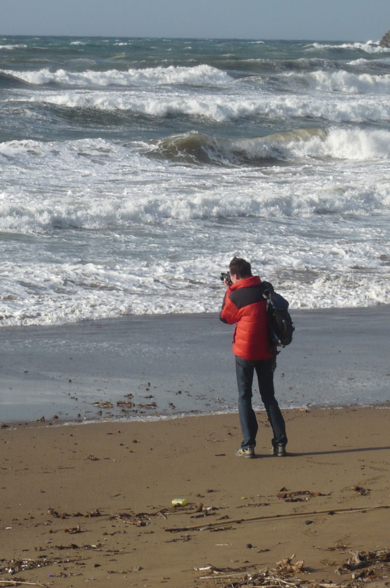 The Tourist Baratti Golfo Di Baratti Italy Sea And Sky Waves Man Taking Picture Man Taking Photo Early Spring