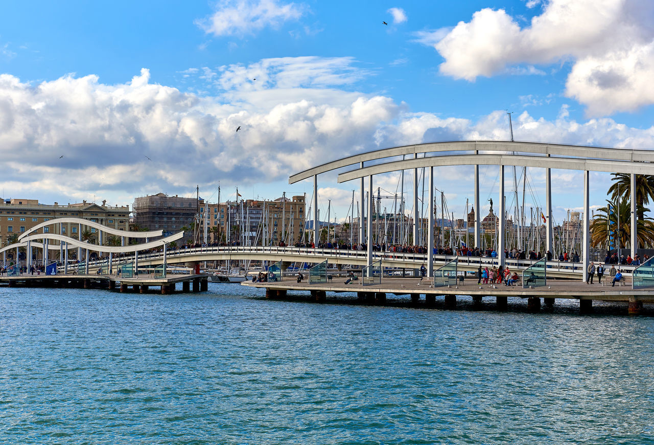 Barcelona, Spain - April 3, 2016: Rambla de Mar and Port Vell in Barcelona city. Crowd of people walking across the swing bridge on the Rambla de Mar. The Rambla del Mar is a main tourist attraction in Barcelona. Spain Architecture Barcelona, Spain Catalonia Cloudy Sky Crowd Of People Editorial  Europe Famous Place Footbridge Landmark Landscape Marina Marine Mediterranean Sea Outdoors Pathway Pedestrian Walkway People Promenade Rambla Del Mar SPAIN Sunny Day Swing Bridge Travel Destinations Walking