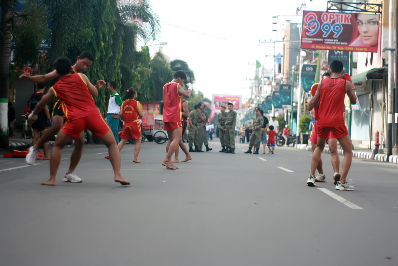 weekend activity in dhoho street, kediri eastjava Indonesia Adult Adults Only Asian  Asian Culture Authentic City Crowd Day Large Group Of People Men Outdoors People Real People Road Tree Women