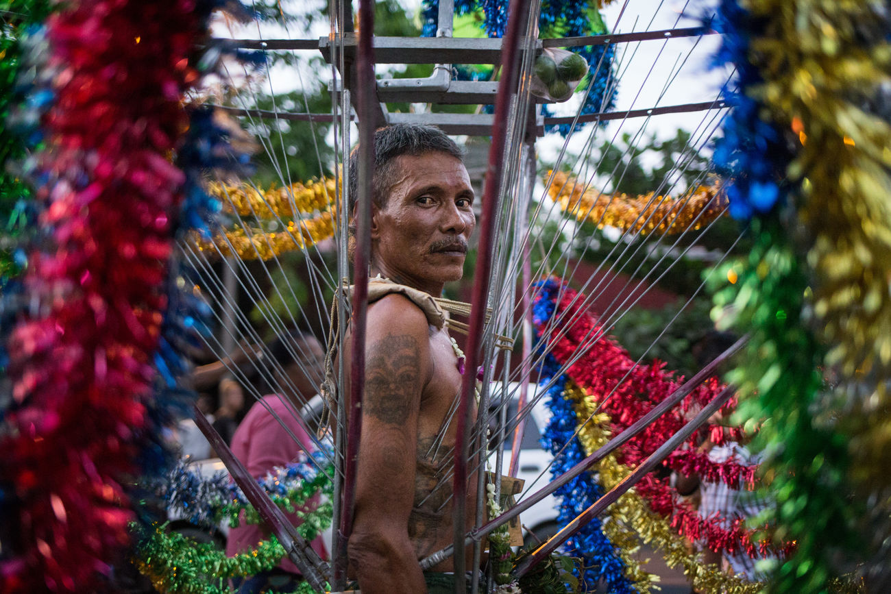 One of the devotees during the Fire Walking Festival (Mee Nin Pwe) - a celebration taking place each Spring at the Hinduist temple of Sri Mariamman in Yangon, Myanmar. Burma Celebration Decorations Devotee Devotion Eye Contact Festival Fire Walking Garland Hindu Hinduism Mariamman Mee Nin Pwe Myanmar Rangoon Ritual Selfmutilation South East Asia Spirituality Street Photography Streetphotography Tatoo Temple Travel Photography Yangon The Week On EyeEm