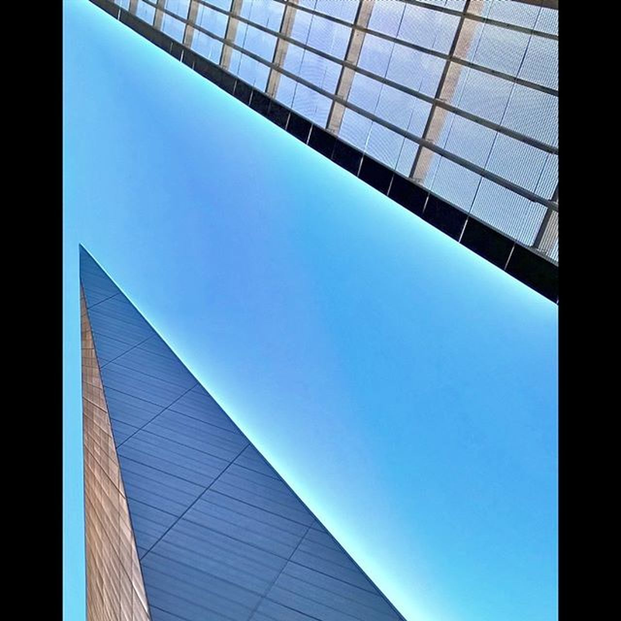 architecture, low angle view, blue, built structure, no people, modern, clear sky, day, skyscraper, sky, building exterior, outdoors, close-up