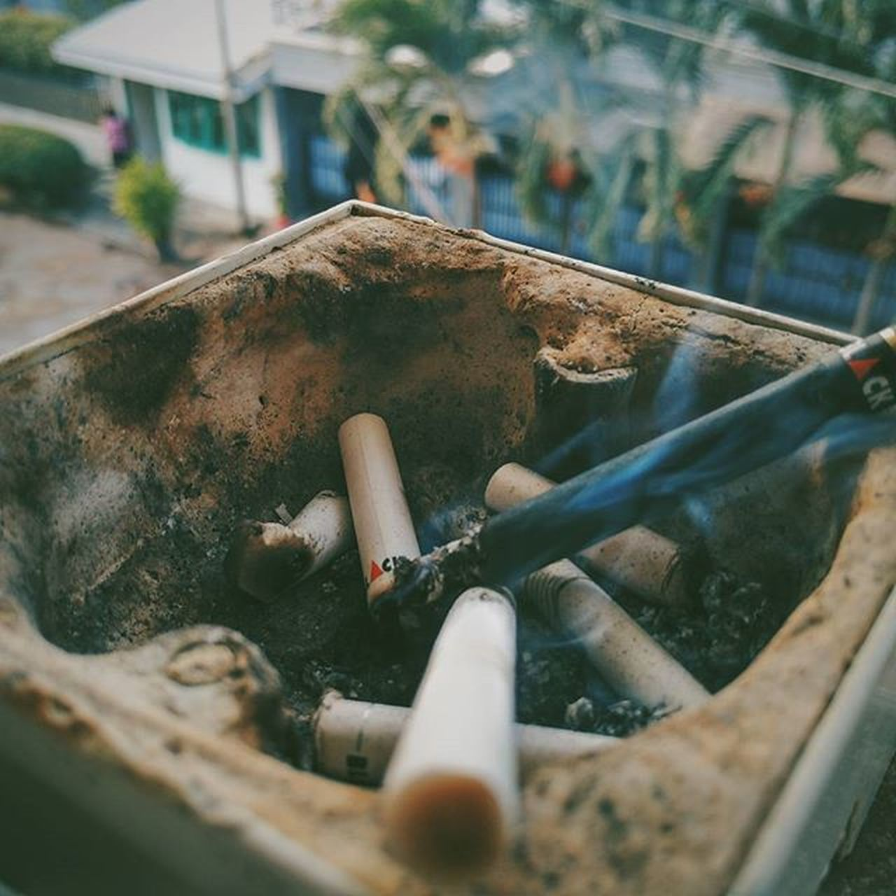 bad habit, high angle view, no people, addiction, work tool, day, ashtray, outdoors, ash, close-up