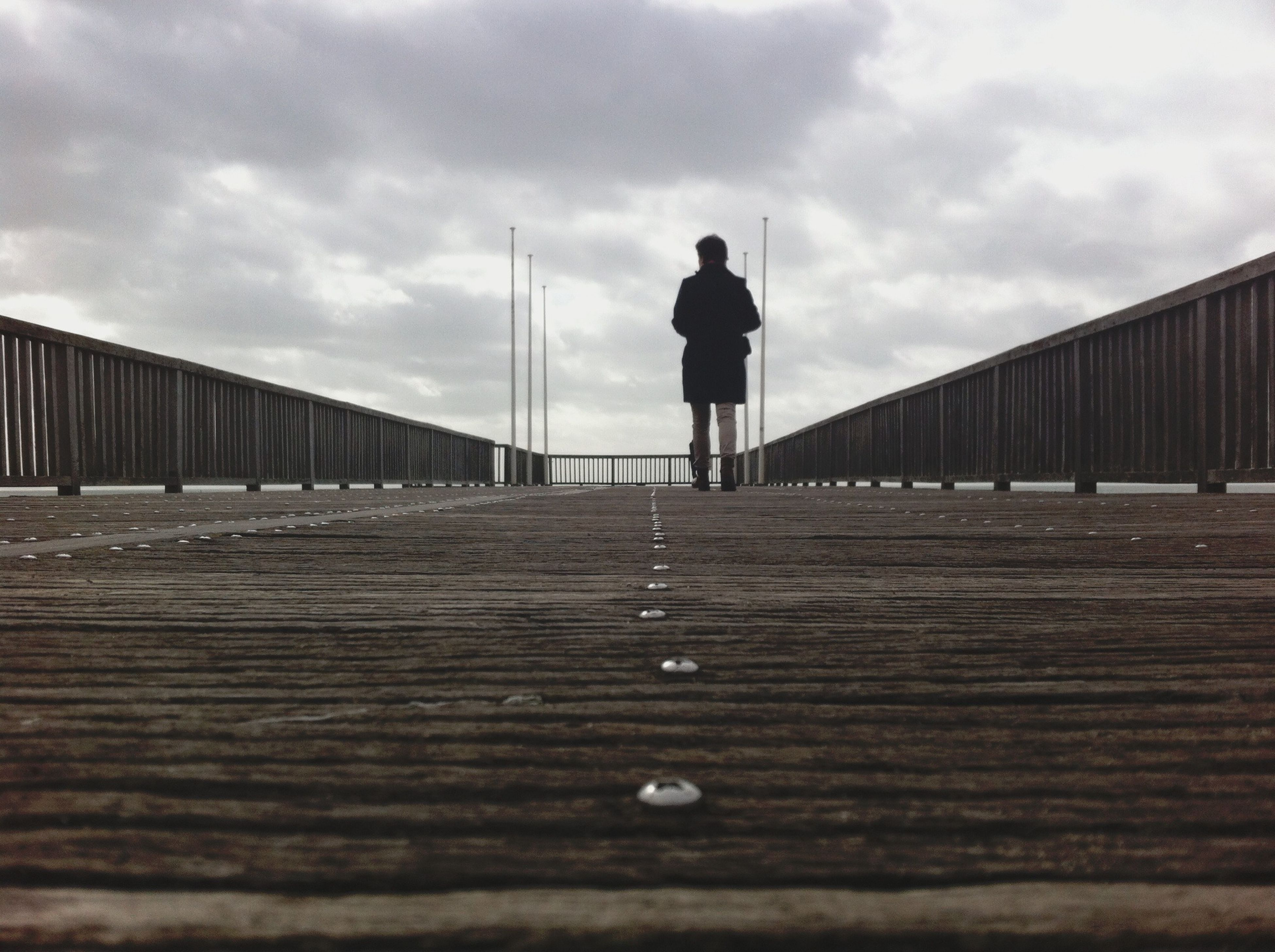 sky, rear view, built structure, railing, architecture, full length, cloud - sky, the way forward, walking, standing, men, lifestyles, leisure activity, cloud, pier, cloudy, surface level, silhouette