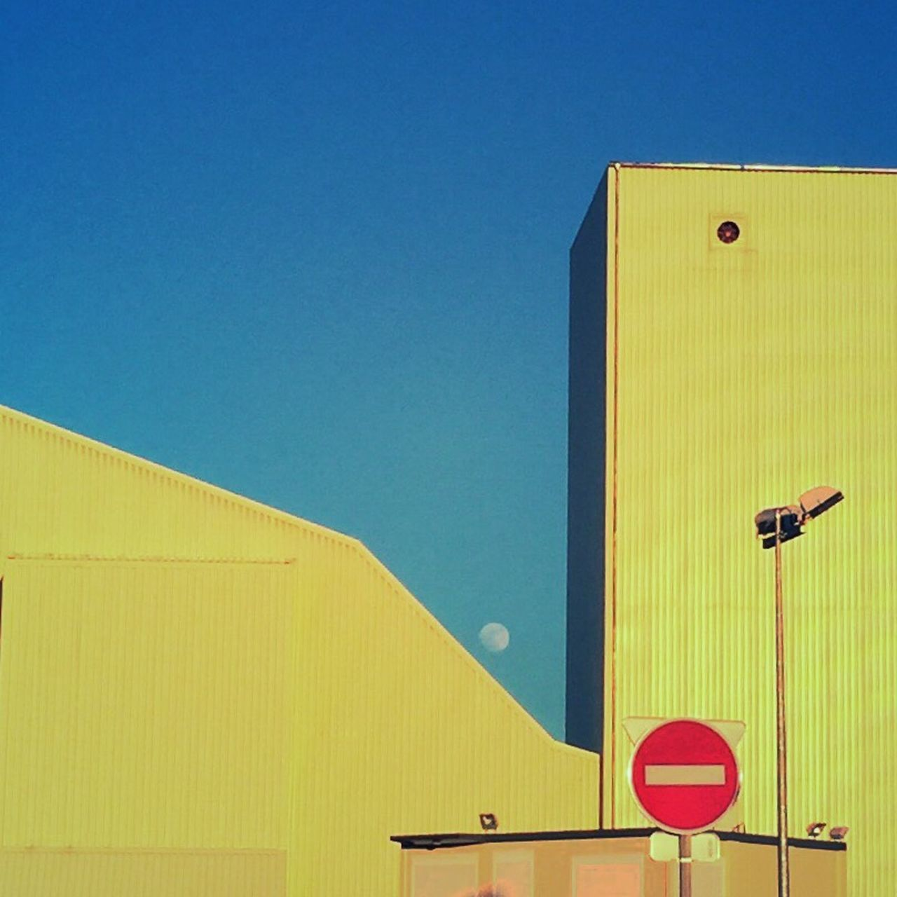 Clear Sky Low Angle View Yellow No People Building Exterior Built Structure Outdoors Architecture Day Close-up Sky Factoryimage Factory Zone Factory Building Sunset Moonlight Clear Sky Factory Yellow Light Scenics Modern Building