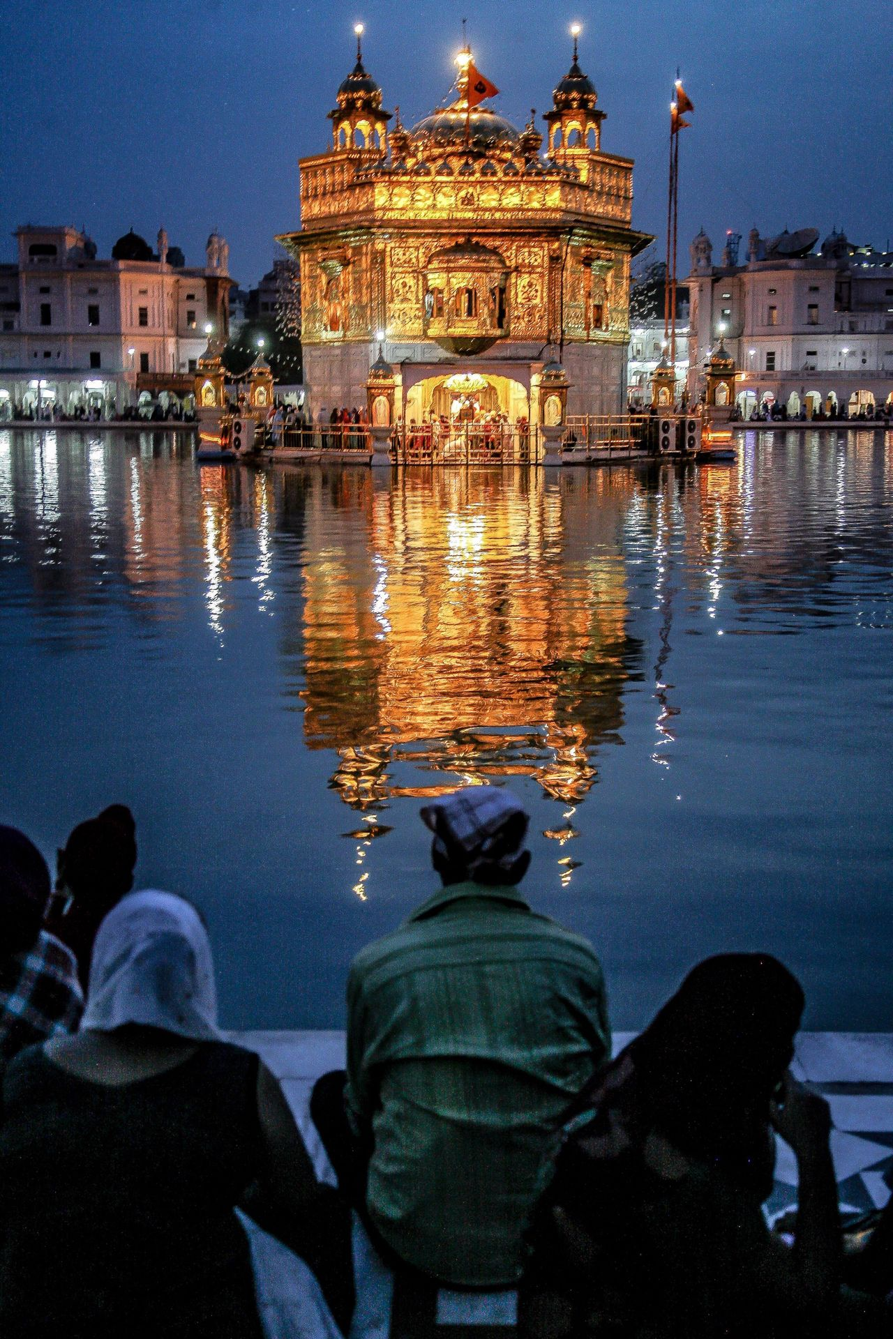 Architecture Travel Destinations Real People Place Of Worship Illuminated Amritsar Golden Temple India Sikhism Pilgrimage