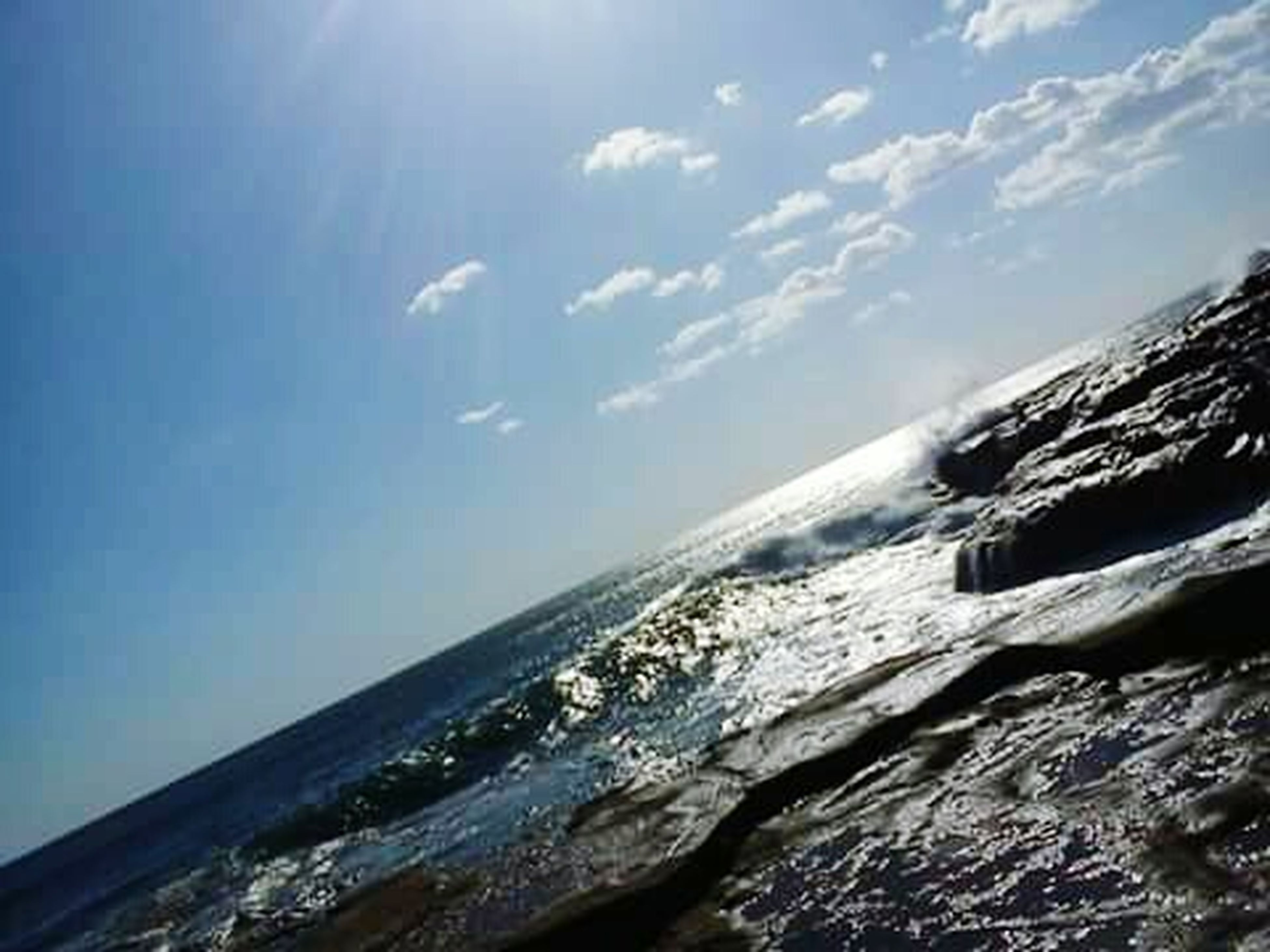 sea, scenics, beauty in nature, water, horizon over water, tranquil scene, sky, tranquility, nature, blue, mountain, idyllic, sunlight, day, outdoors, cloud - sky, beach, rock - object, no people, remote