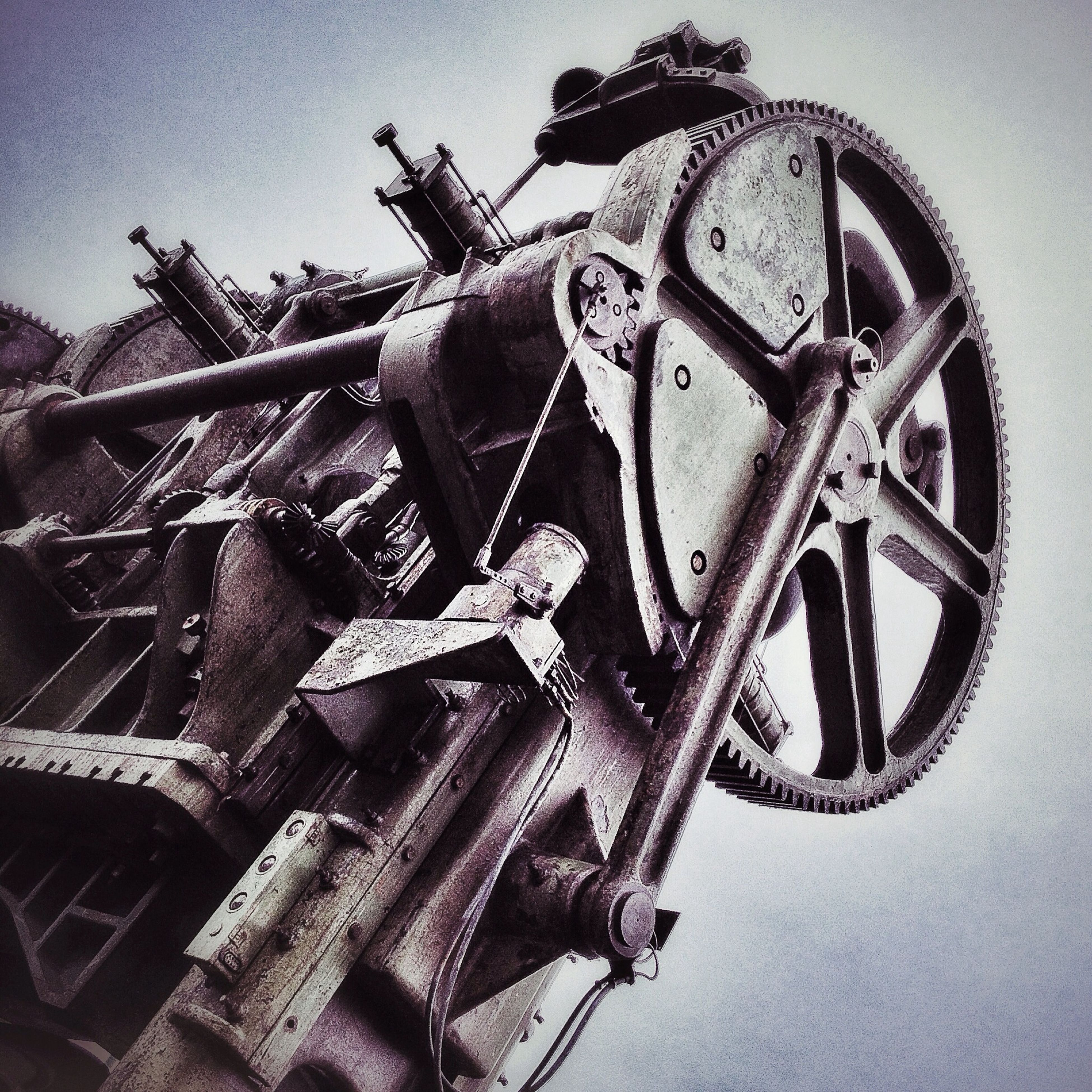 old, metal, obsolete, abandoned, rusty, deterioration, damaged, low angle view, run-down, close-up, sky, metallic, wheel, clear sky, outdoors, no people, machinery, transportation, day, weathered