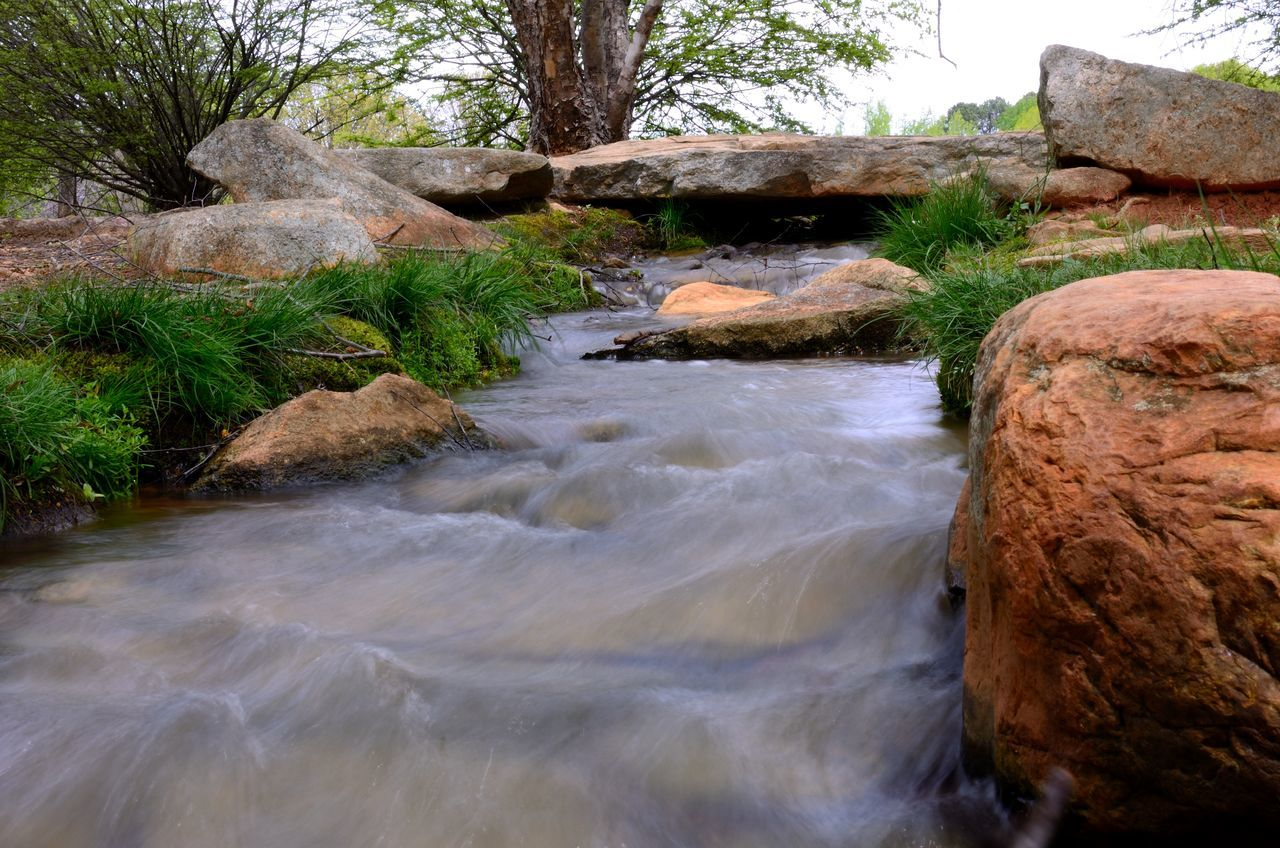 Architecture Beauty In Nature Creek Day Flowing Flowing Stream Flowing Water Long Exposure Motion Nature No People Outdoors River Rock Rock - Object Rock And Sea Rock Formation Scenics Sky Tranquility Tree Water Water Reflections Waterfall