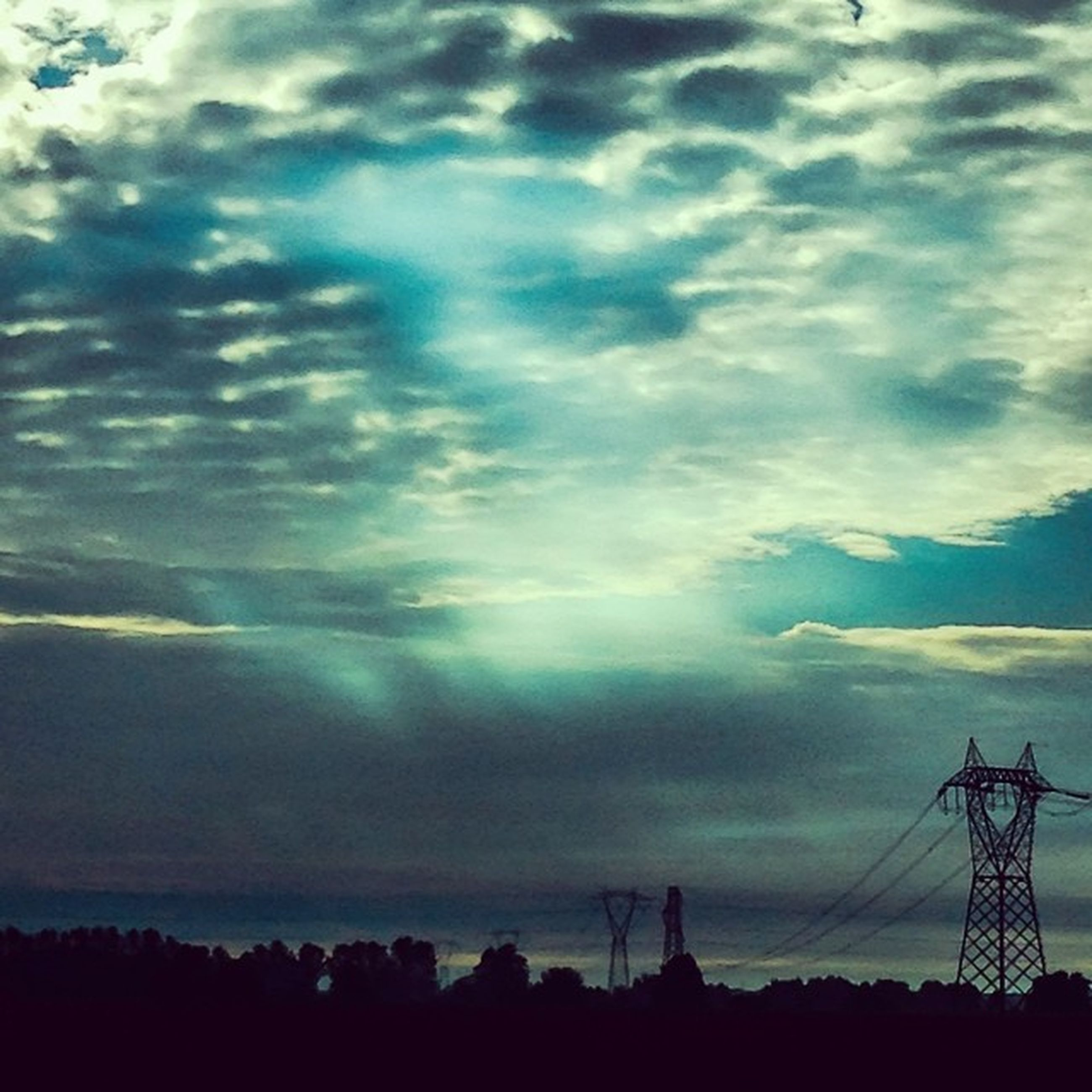 silhouette, sky, electricity pylon, power line, electricity, cloud - sky, power supply, fuel and power generation, beauty in nature, tranquility, scenics, low angle view, connection, tranquil scene, cloudy, sunset, nature, cable, technology, cloud