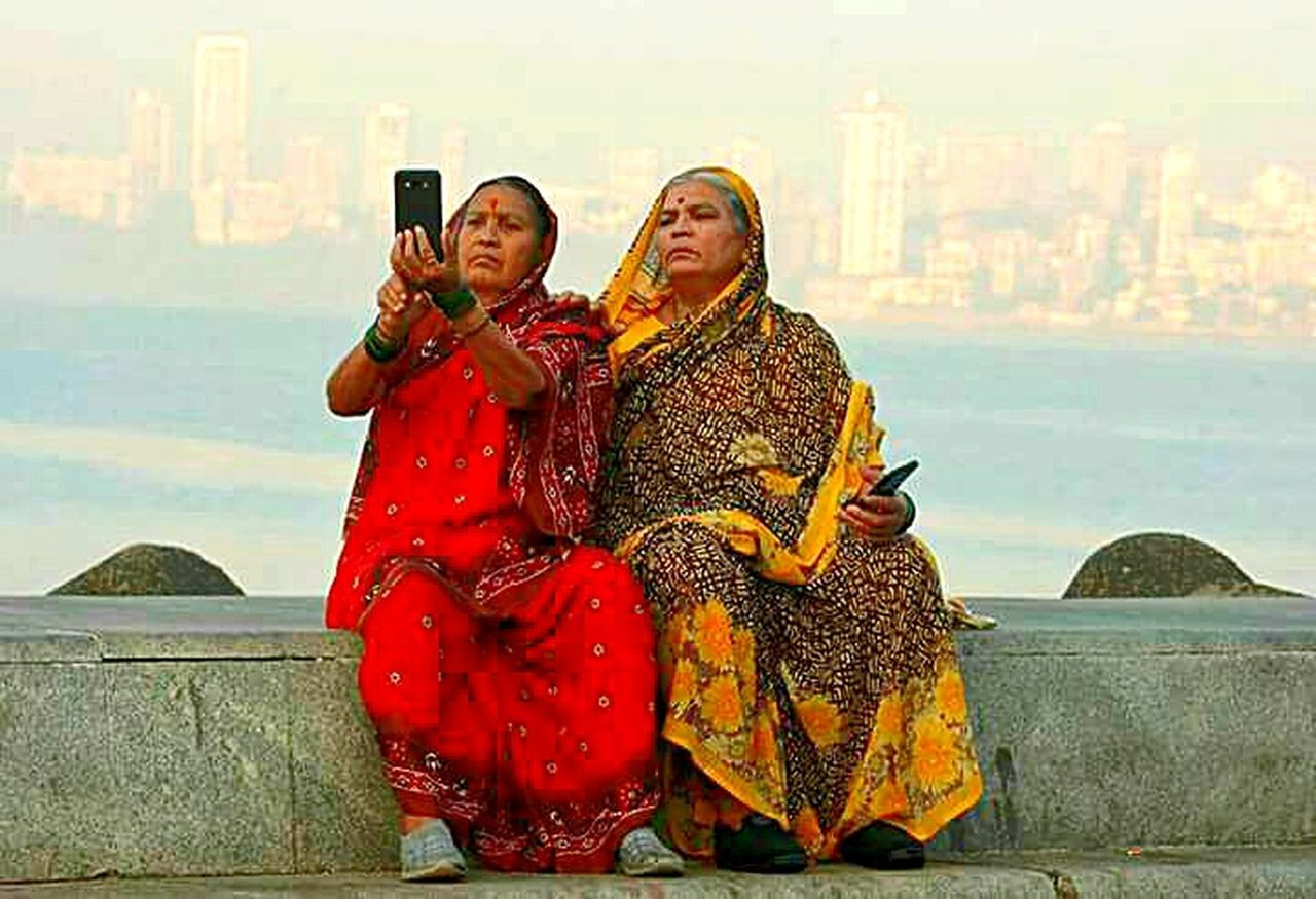 My friend send me from Bombay.... Traditional Clothing Two People Sitting Two Is Better Than One Adults Only Two Old Young Heart Woman Selfie ✌ Mood Togetherness Cityscape Outdoors City Urban Skyline Sea Scenics IMography EyeEm Incredible India EyeEm Best Shots Malephotographerofthemonth Something I Like My Smartphone Life EyeEm Gallery Eyeem Photography Always Find A Reason To Smile With Love From India💚 truly...urs... Nitin
