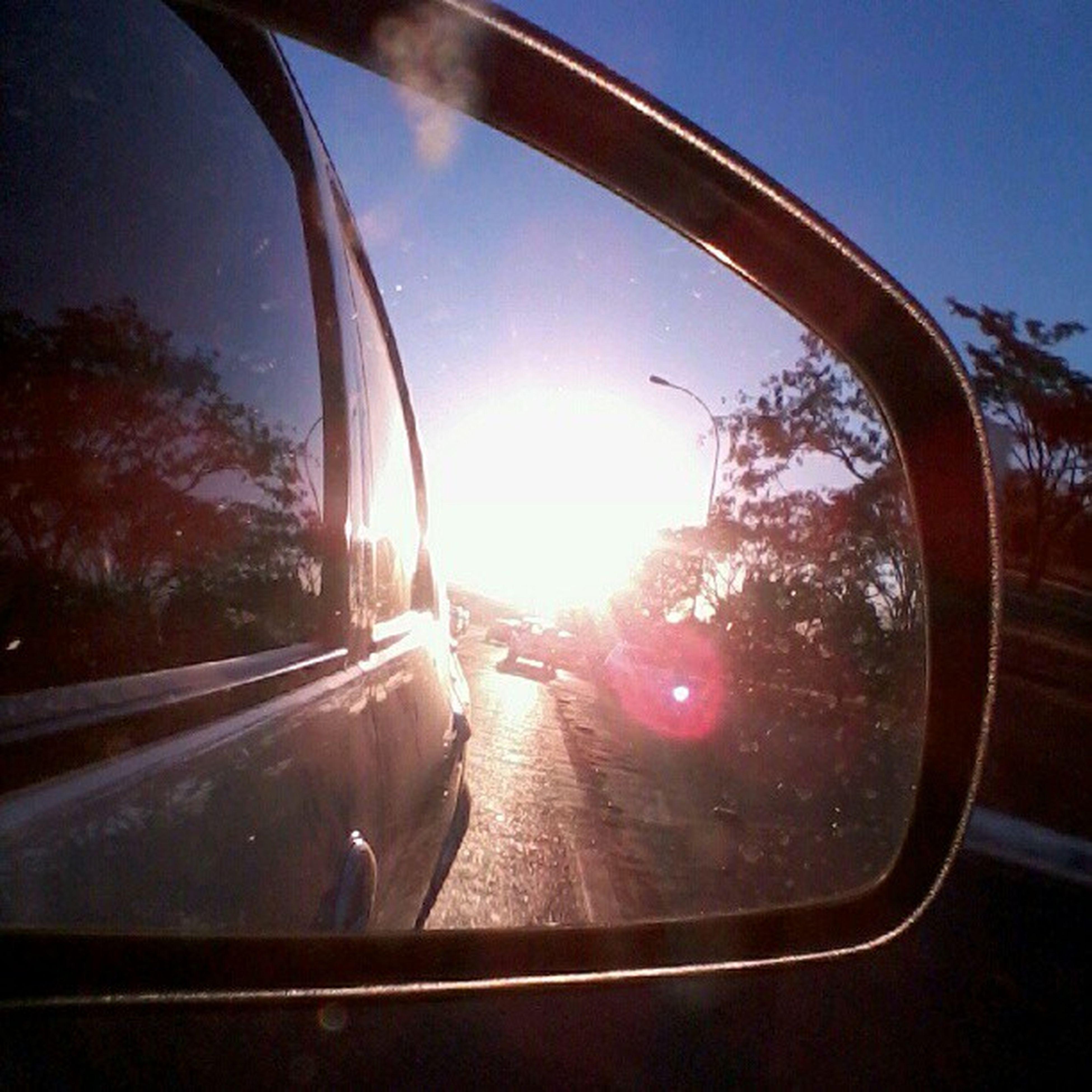 transportation, car, glass - material, transparent, mode of transport, land vehicle, vehicle interior, side-view mirror, car interior, sun, windshield, road, window, tree, reflection, sunlight, sky, sunbeam, lens flare, travel