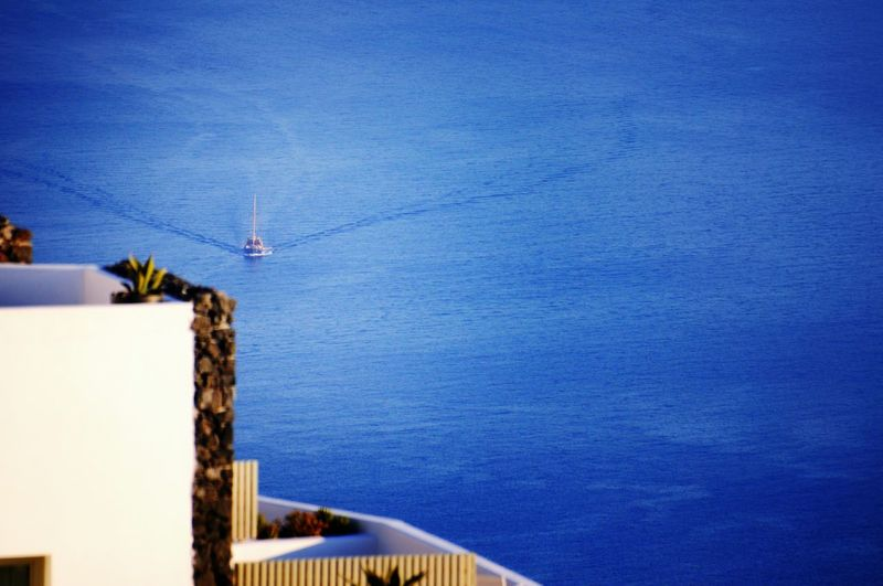 Showcase March Deep Blue Sea View From Above Sailboat Sailing From My Point Of View EyeEm Best Shots Eye4photography  Crossing The Sea Seascape Sea View Summertime Blue Wave The Essence Of Summer - Greek Islands Santorini Greece