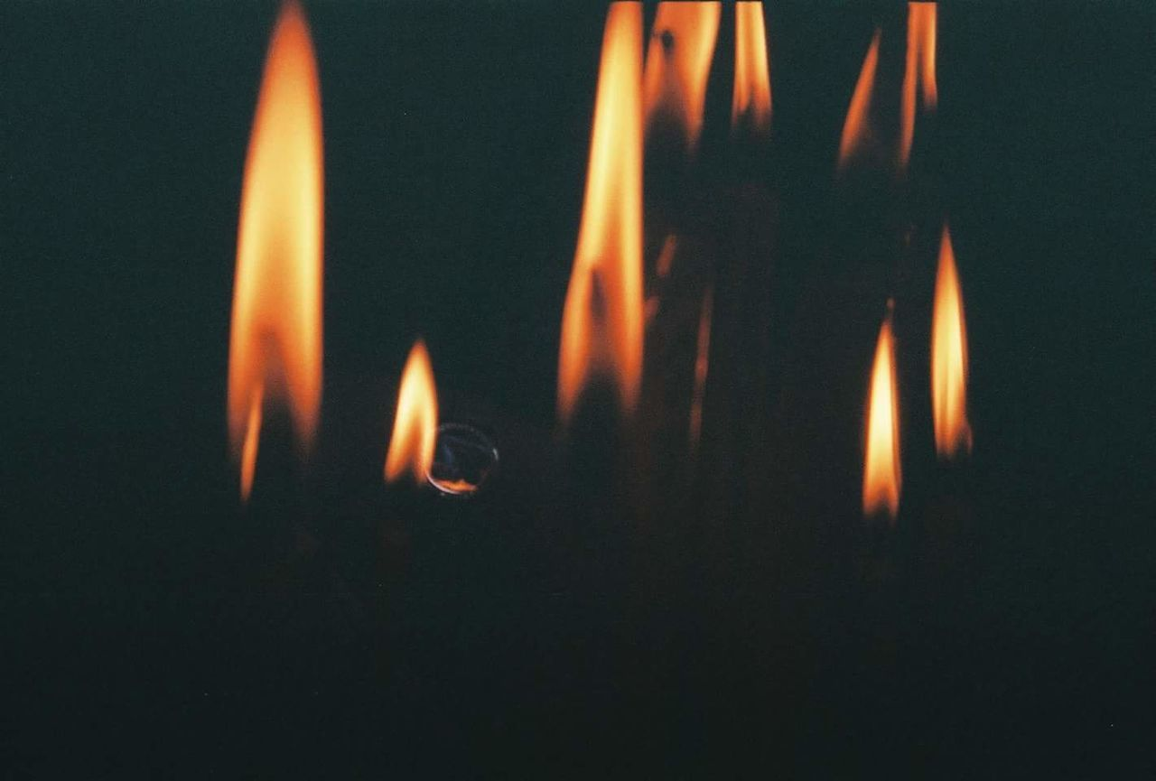 flame, burning, heat - temperature, candle, glowing, no people, night, close-up, illuminated, outdoors, diya - oil lamp, black background