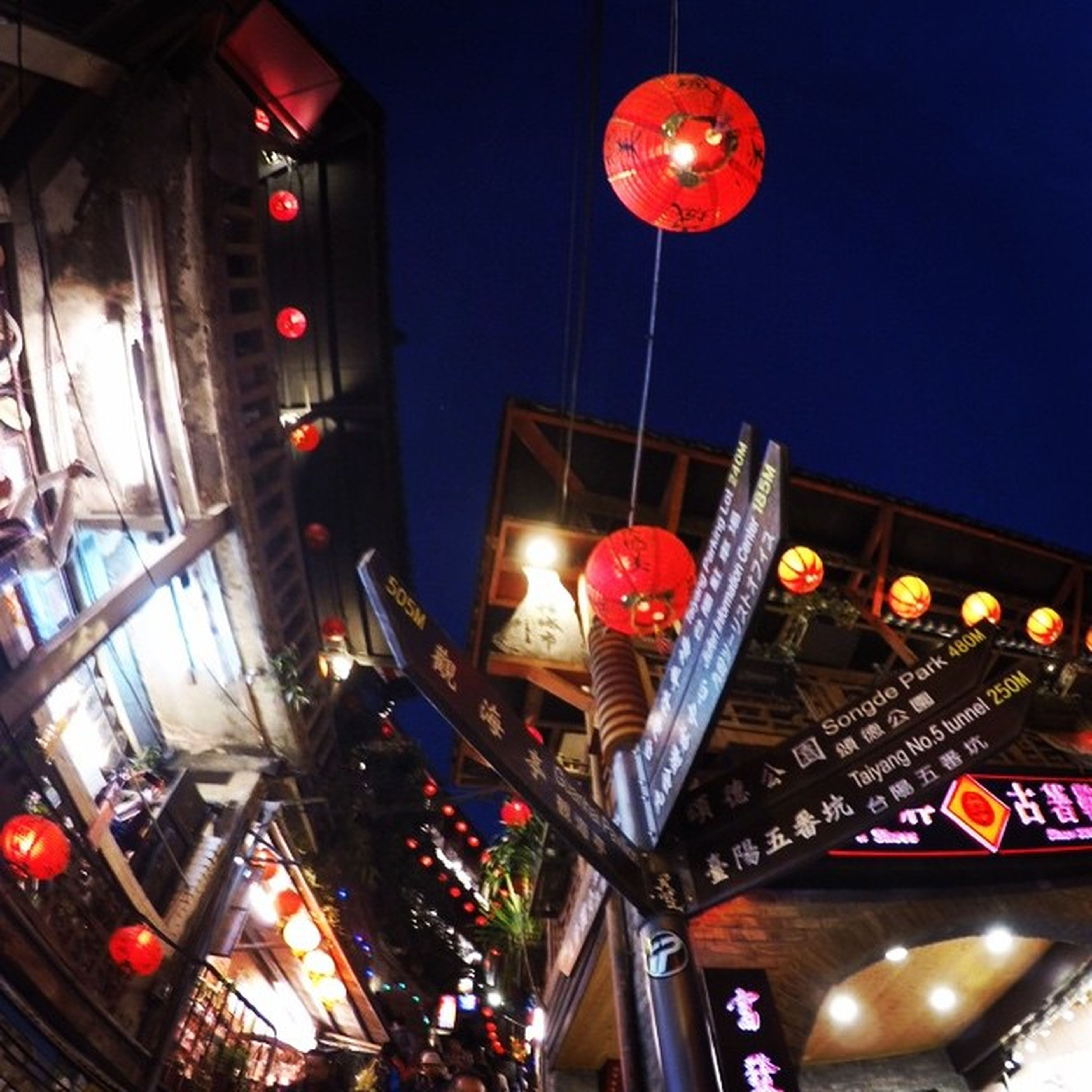 illuminated, low angle view, lighting equipment, night, decoration, lantern, architecture, built structure, hanging, multi colored, celebration, red, building exterior, chinese lantern, ceiling, in a row, electric light, indoors, no people, street light