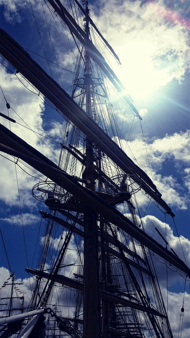 mast, cloud - sky, sky, nautical vessel, low angle view, rigging, transportation, sailboat, day, mode of transport, outdoors, tall ship, no people, sailing ship, sunlight, moored, sailing, nature
