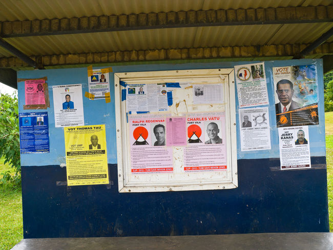 Election Posters Efate Island Port Vila Vanuatu Architecture Art Art And Craft Building Exterior Built Structure Colorful Creativity Election Election Campaign Election Day Green Color Human Representation In A Row Melanesian Multi Colored No People Outdoors Pacific Posters Retail