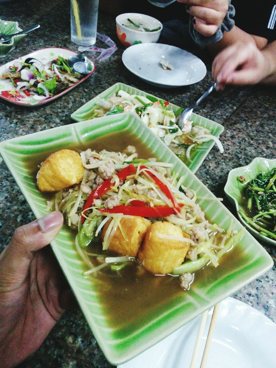 human hand, human body part, food and drink, food, real people, one person, holding, human finger, plate, freshness, ready-to-eat, bowl, table, chopsticks, healthy eating, close-up, serving size, fork, lifestyles, high angle view, indoors, meal, slice, eating, women, men, day, people