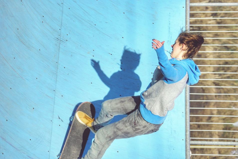Blue Wave Skateboarding Skatepark Mini Ramp Sports Photography Casual Clothing Leisure Activity Blue Background Heavenly Blue Woman Long Hair Challenge Fun Young Adult Outdoors Day One Person Adult Kickturns Minimal Blue Color Blue Backround Pastel Blue Action Shot  Motion Women Around The World