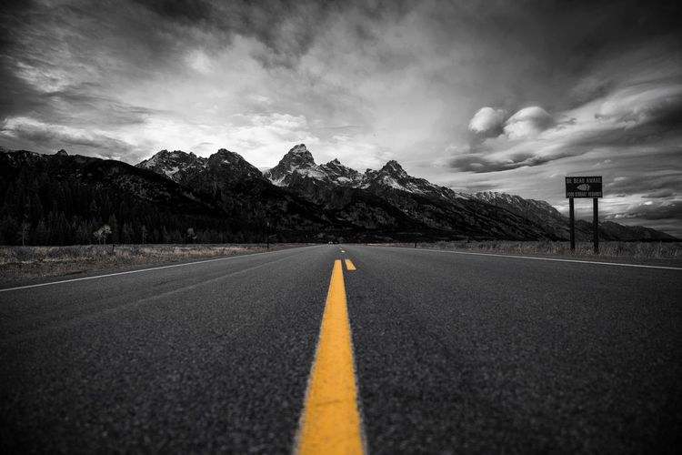Grandness. Road Road Marking The Way Forward Mountain Sky Cloud - Sky Highway Yellow Outdoors Landscape Nature Grand Teton National Park  National Park Grand Teton National Park, Wyoming Wyoming Blackandwhite Black And White Black & White Color Pop Asphalt Skyporn Sky And Clouds USA USAtrip Roadtrip