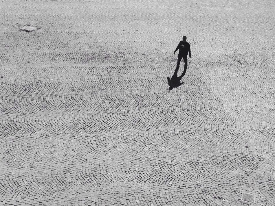 A Bird's Eye View Blackandwhite Street Streetphotography Walking High Angle View Solitude Tranquility Vacations Men Summer