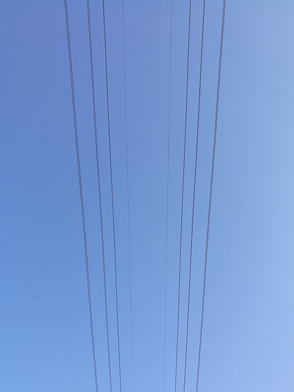 cable, low angle view, clear sky, no people, power line, connection, outdoors, day, blue, nature, sky