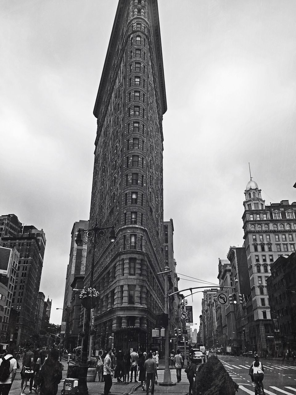architecture, building exterior, large group of people, built structure, tall - high, tower, skyscraper, city, real people, sky, day, travel destinations, city life, outdoors, history, men, women, lifestyles, modern, crowd, cityscape, people