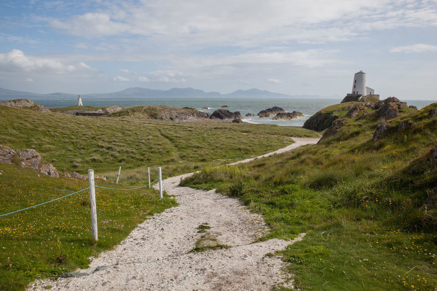 Anglesey Beach Beauty In Nature Britain Coast Coastline Dwynwen Footpath Grass Gwynedd Island Landscape Lighthouse Llanddwyn Island Nature Non-urban Scene Outdoors Remote Ruins Scenics Summer The Way Forward Tidal Tranquility Wales