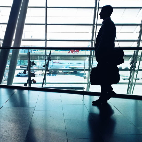 Alone Ceiling Flooring Glass - Material Airport Business Airports Airportphotography Travel Traveling Businesstrip Business Man Business Trip Indoors  Silhouettes Modern Occupation Swissair Shadow Staircase Steps Steps And Staircases Transparent Wall Window