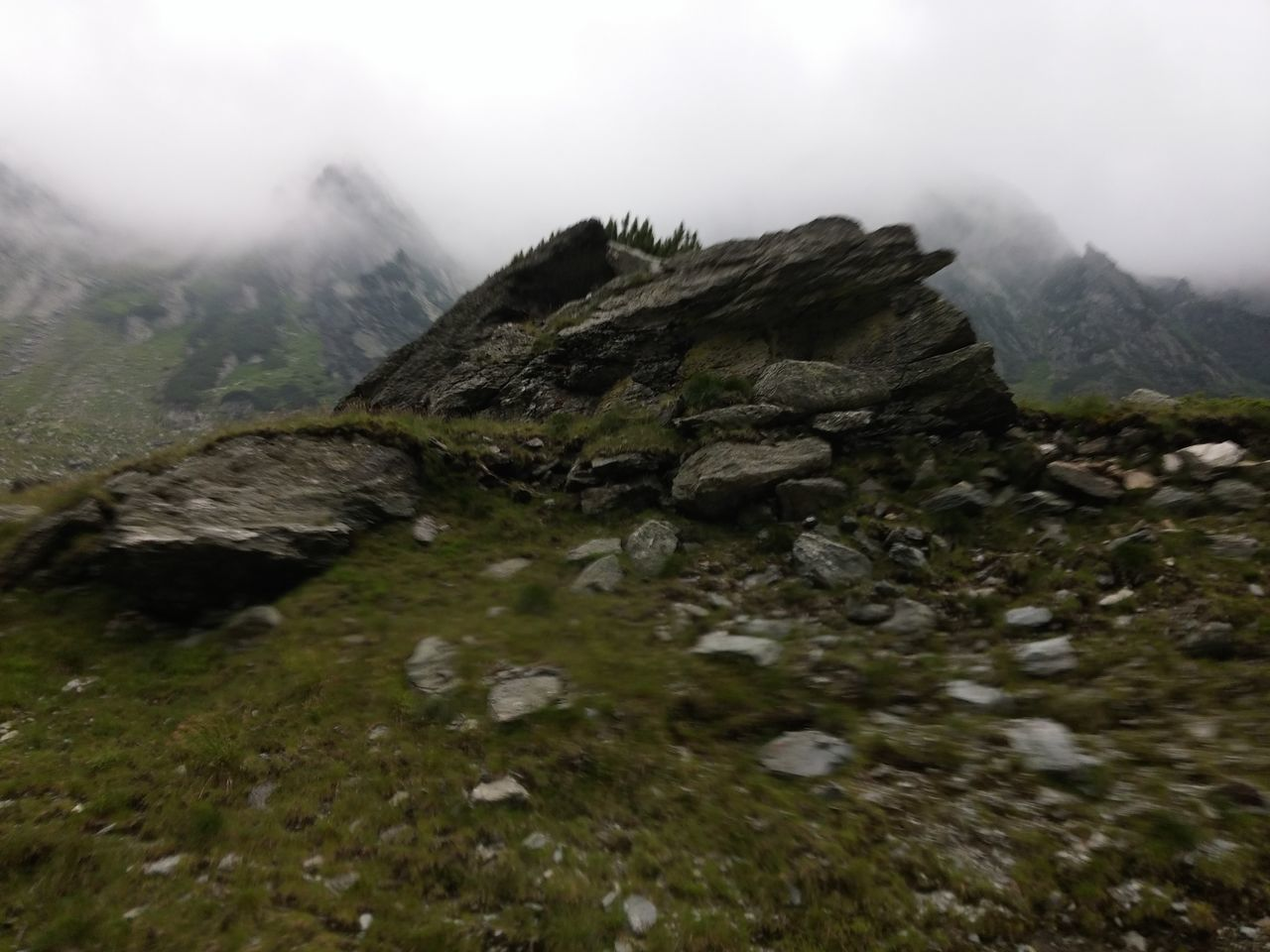 nature, mountain, beauty in nature, rock - object, fog, outdoors, day, no people, landscape, tranquility, scenics, water, tranquil scene, sky