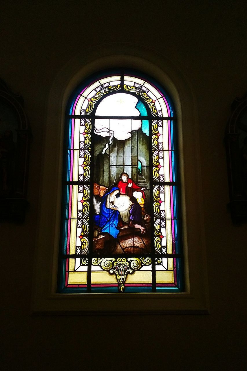 window, real people, indoors, religion, place of worship, spirituality, men, architecture, day, one person