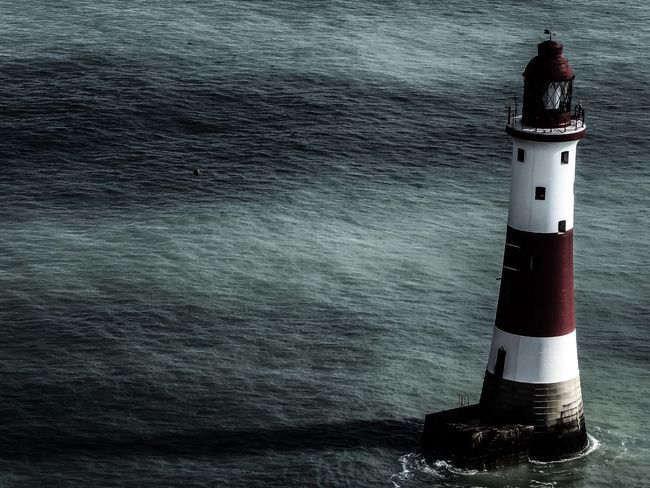 Lighthouse and Dark Skies Water Surface No People Sea Seascape Architecture Architecture_collection Lighthouse @ Beachy Head OpenEdit Light And Shadow Creative Light And Shadow
