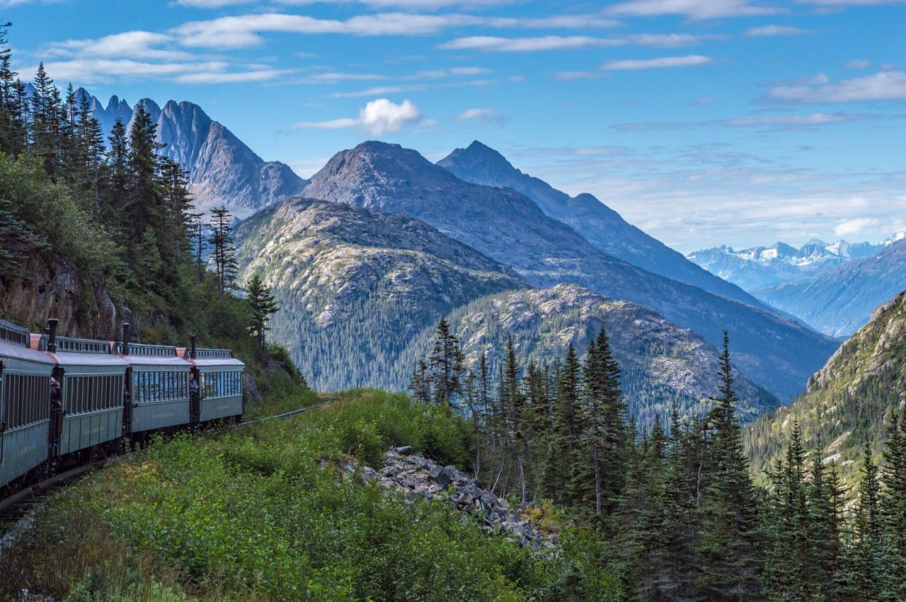 The Great Outdoors - 2017 EyeEm Awards Transportation Mountain Nature Sky Train - Vehicle Rail Transportation Mode Of Transport Beauty In Nature Tree No People Day Scenics Cloud - Sky Outdoors