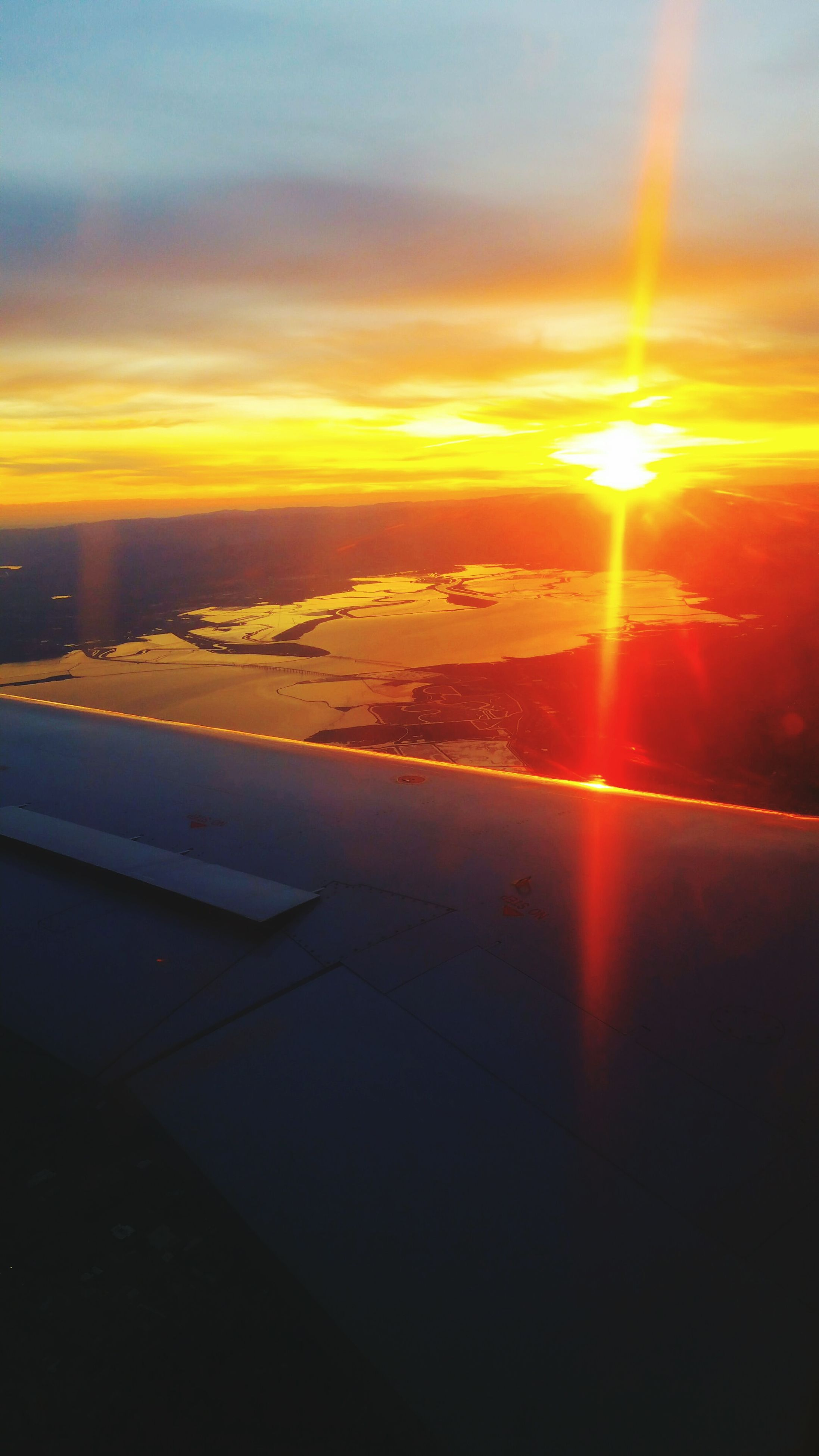 sunset, sun, airplane, sky, flying, transportation, scenics, orange color, air vehicle, cloud - sky, beauty in nature, aerial view, aircraft wing, sunlight, mode of transport, nature, sunbeam, tranquil scene, tranquility, travel