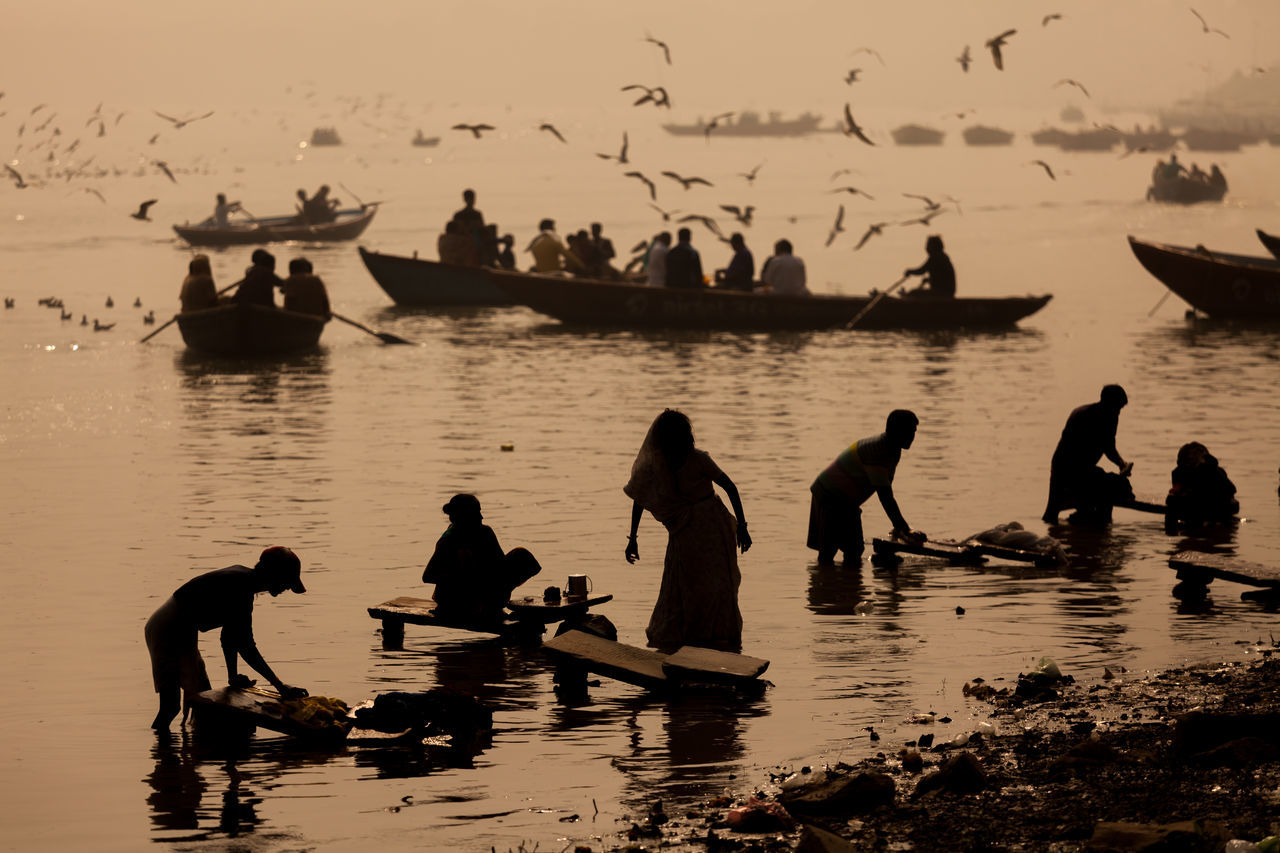 Laundry service by the Ganga river, while tourist taking boat trip to enjoy the sunrise view of Varanasi, India. Animals In The Wild Beauty In Nature Boat Devotion Ganga Hinduism Holi Incredible India India Laundry Lifestyle Religion River Silhouette Varanasi Wanderlust Water