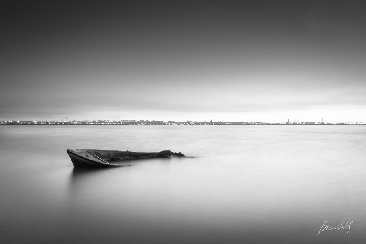"""""""Sunk And Relaxed"""" 📷 Portugal Moita River Boat Sunk Tejo Tejo River Tagus Tagus River Rio Rio Tejo Long Exposure Landscape Black And White Black & White EyeEmNewHere EOS700D Bruno Neves Beach Rosario Water Tranquility Tranquil Scene Outdoors No People"""