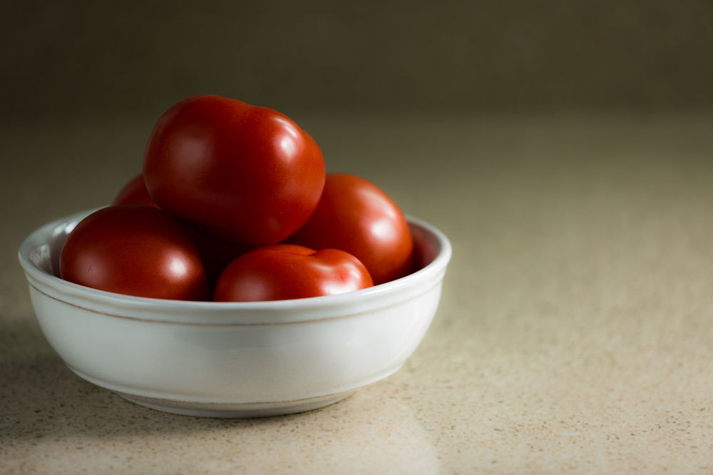 Bowl of organic tomatoes in kitchen. Bowl Close-up Cooking Cooking At Home Food Food And Drink Freshness Healthy Eating Indoors  No People Organic Food Organic Foods Red Still Life Table Tomatoes