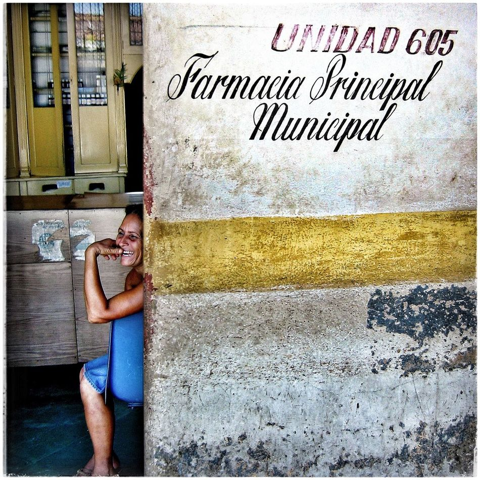 Cuban chemists Cuba UNIDAD Laughing Woman Relaxedand Happy Laidback Amused Waiting For Presciption Cuban Women EyeEmNewHere