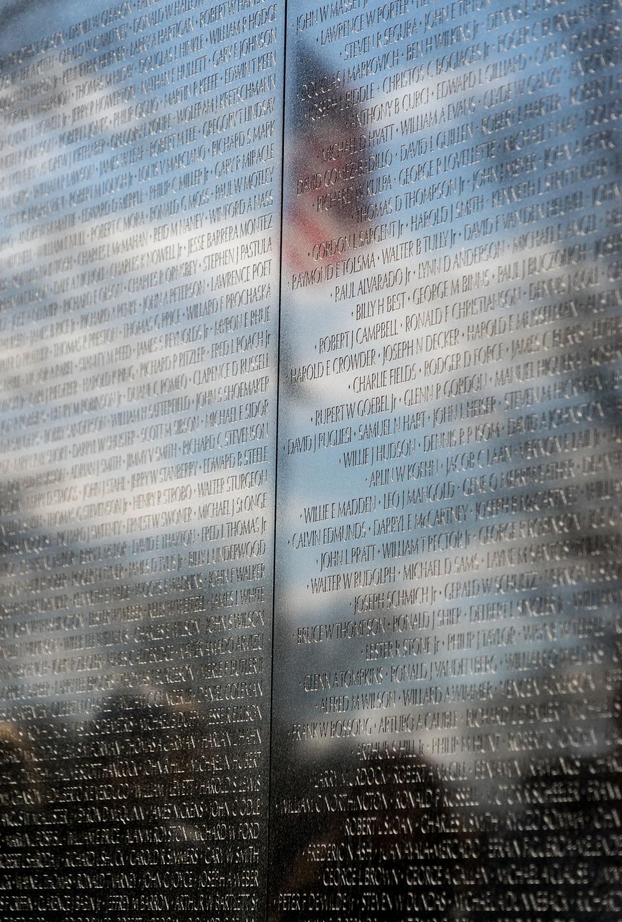 America Capital Cities  D.C. Day Fallen Hand Memorial Names Reflections Sightseeing Soldier USA Vietnam Vietnam War Memorial Wall War Washinton The City Light