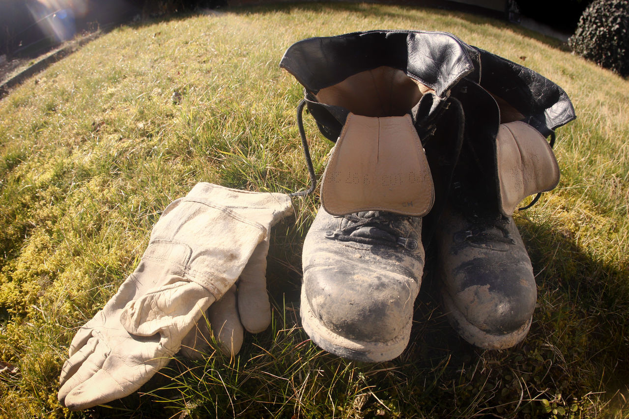 Old shoes Day Grass No People Old Shoes Outdoors Shoes Sport