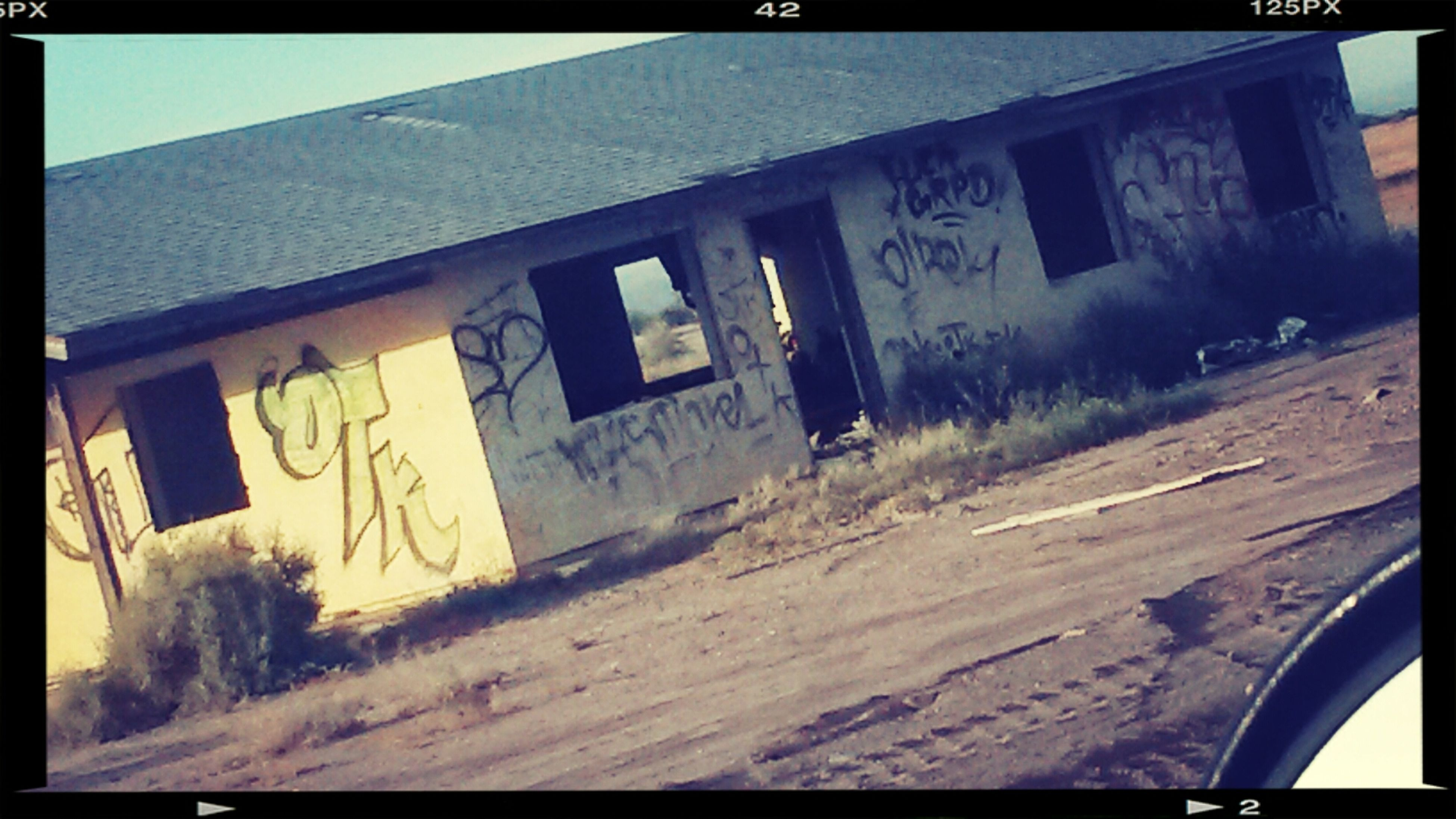 transfer print, auto post production filter, built structure, architecture, building exterior, transportation, window, mode of transport, text, abandoned, land vehicle, house, day, western script, graffiti, car, communication, no people, sky, outdoors