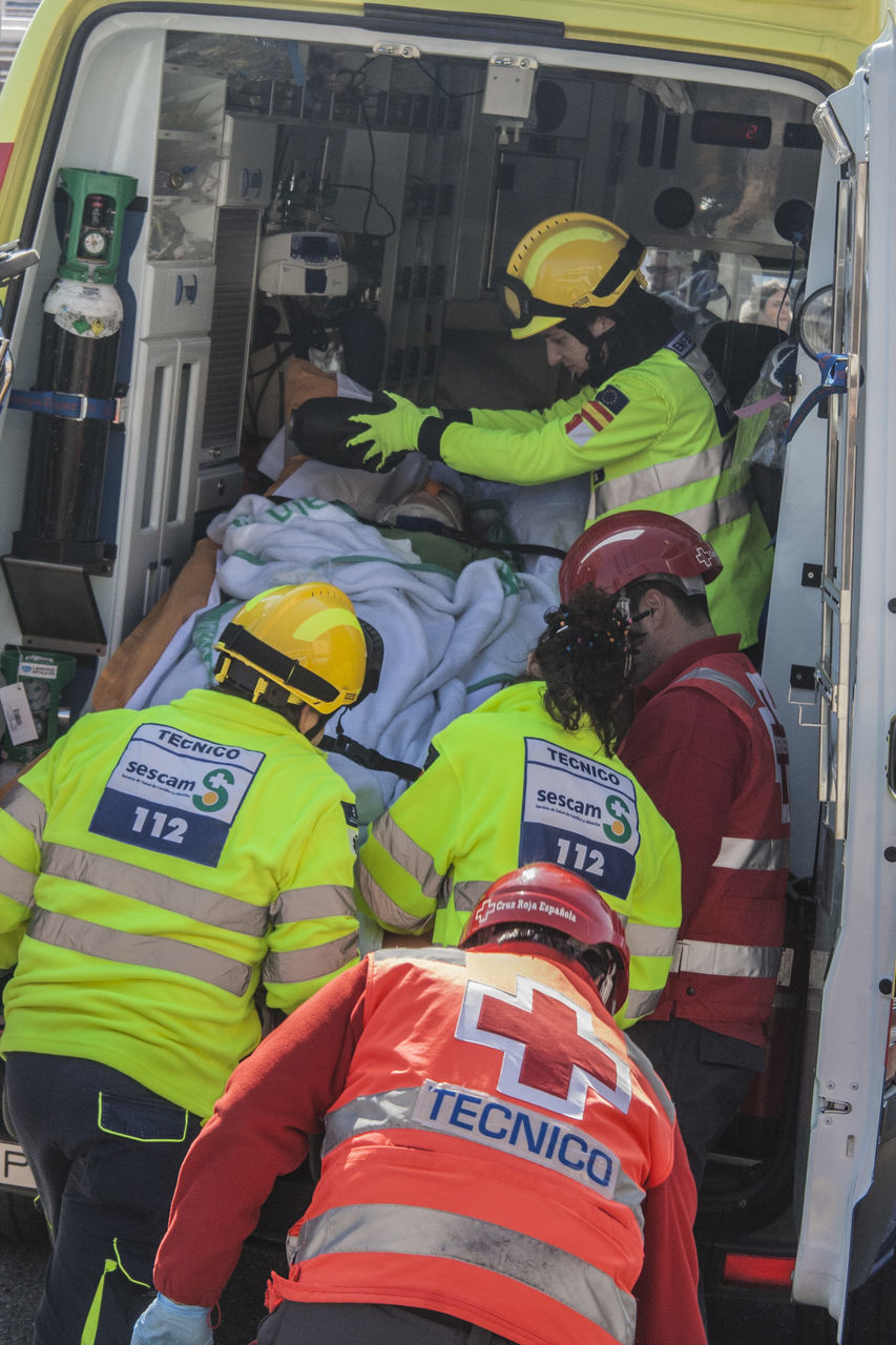 accidents and disasters, text, rescue, real people, firefighter, emergency services occupation, communication, men, protective workwear, uniform, emergency equipment, healthcare and medicine, reflective clothing, fire engine, headwear, paramedic, teamwork, day, outdoors, people
