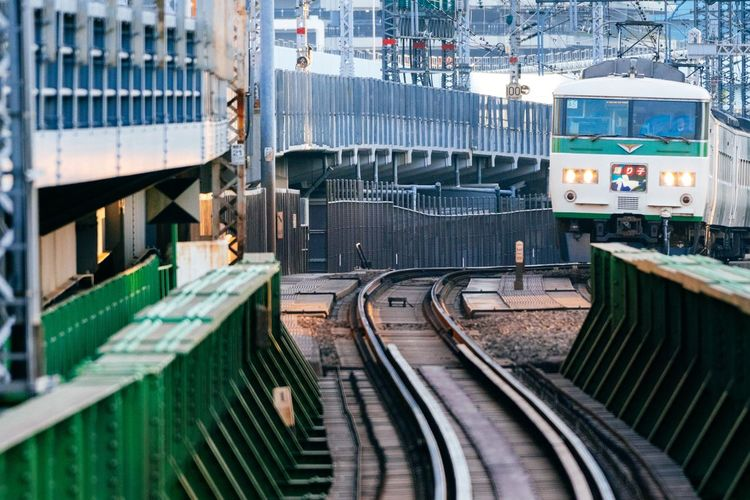 Old Train Approaching Train Station White And Green Green Color Bridge Railway Track Rail Transportation Railroad Track 185 Tokyo,Japan Tokyo Train - Vehicle Transportation Railroad Track Rail Transportation Mode Of Transport No People City Built Structure