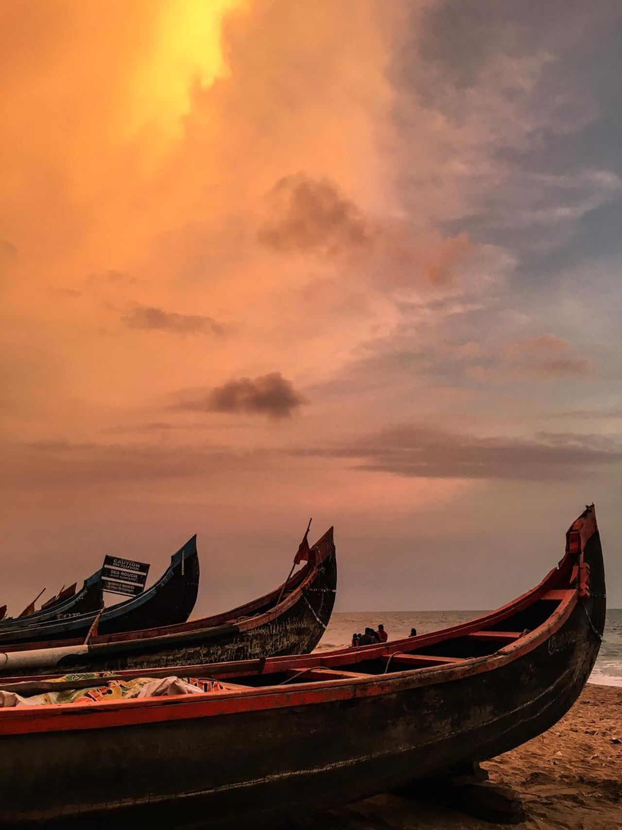 The colors of a sunset Beach Beauty In Nature Boat Cloud - Sky Day Gondola - Traditional Boat Longtail Boat Nature Outdoors Rowboat Scenics Sky Sunset Tranquility Transportation Water Wood - Material