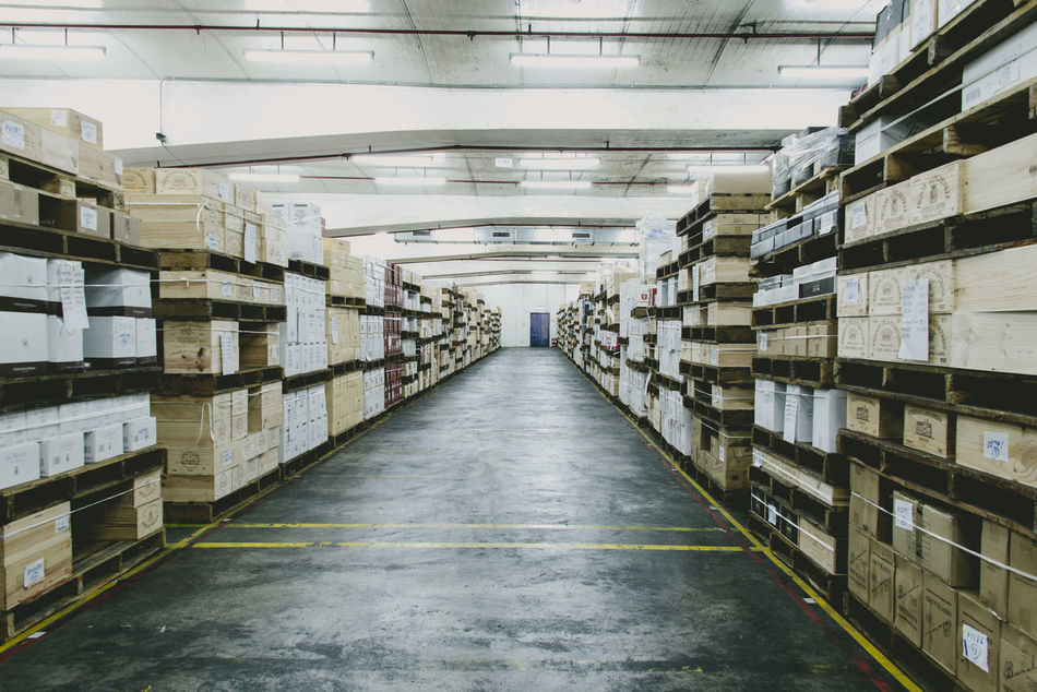 Business Business Finance And Industry Day Distribution Warehouse Factory Indoors  Industry Large Group Of Objects No People Shelf Shipping  Storage Compartment Storage Room Warehouse