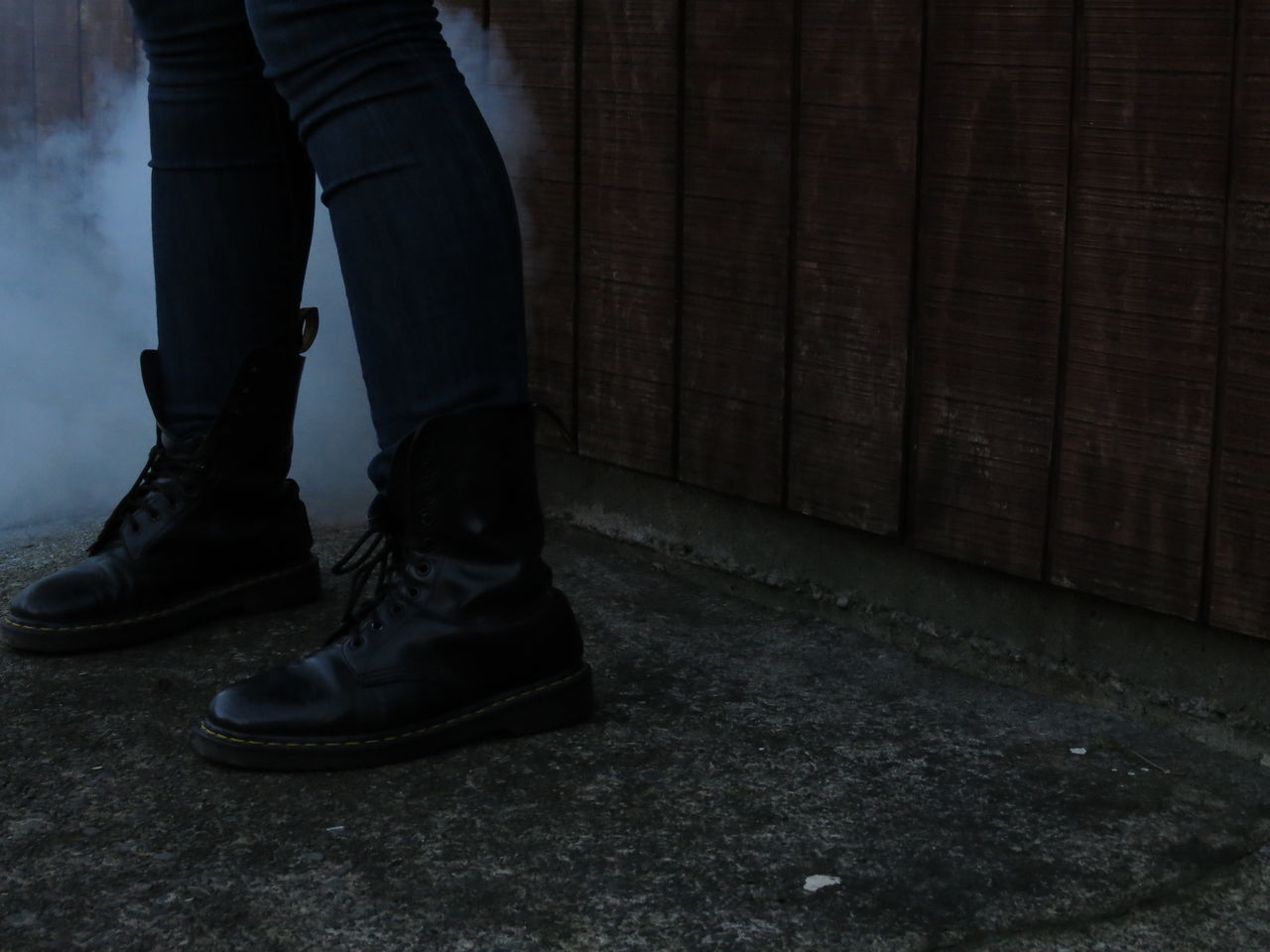 Adult People Human Body Part Surreal Dreamlike Dramatic Smoke And Mirrors Riot Politics And Government Adults Only Day Boots Denim Smoke Cloud Legs Standing Surrealism Weatherboards Edgy Stained Wood Concrete Moody Unfiltered Unedited