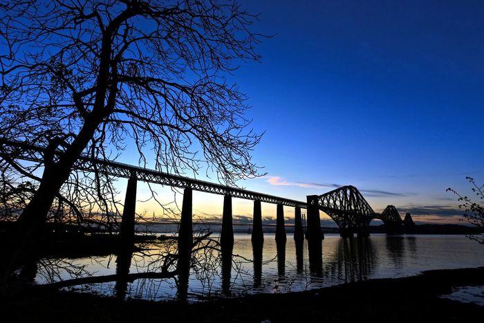Forth Railway Bridge. Bridge Bridge - Man Made Structure Built Structure Engineering Light Outdoors River Silhouette Sky World Heritage