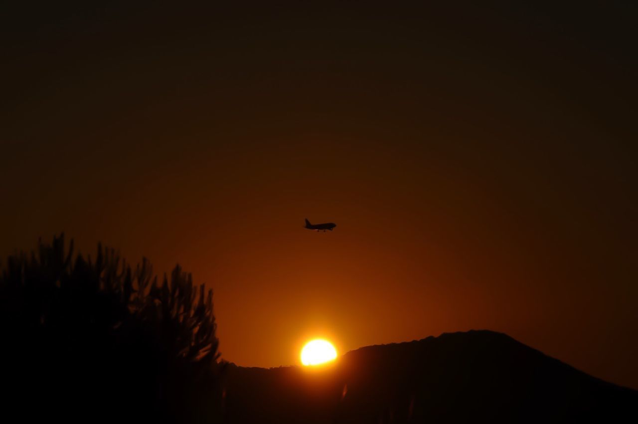 Sunset Silhouette Sun Orange Color Scenics Tranquility Beauty In Nature Tranquil Scene Nature Outdoors Sky Moody Sky No People Romantic Sky Plane Dramatic Sky