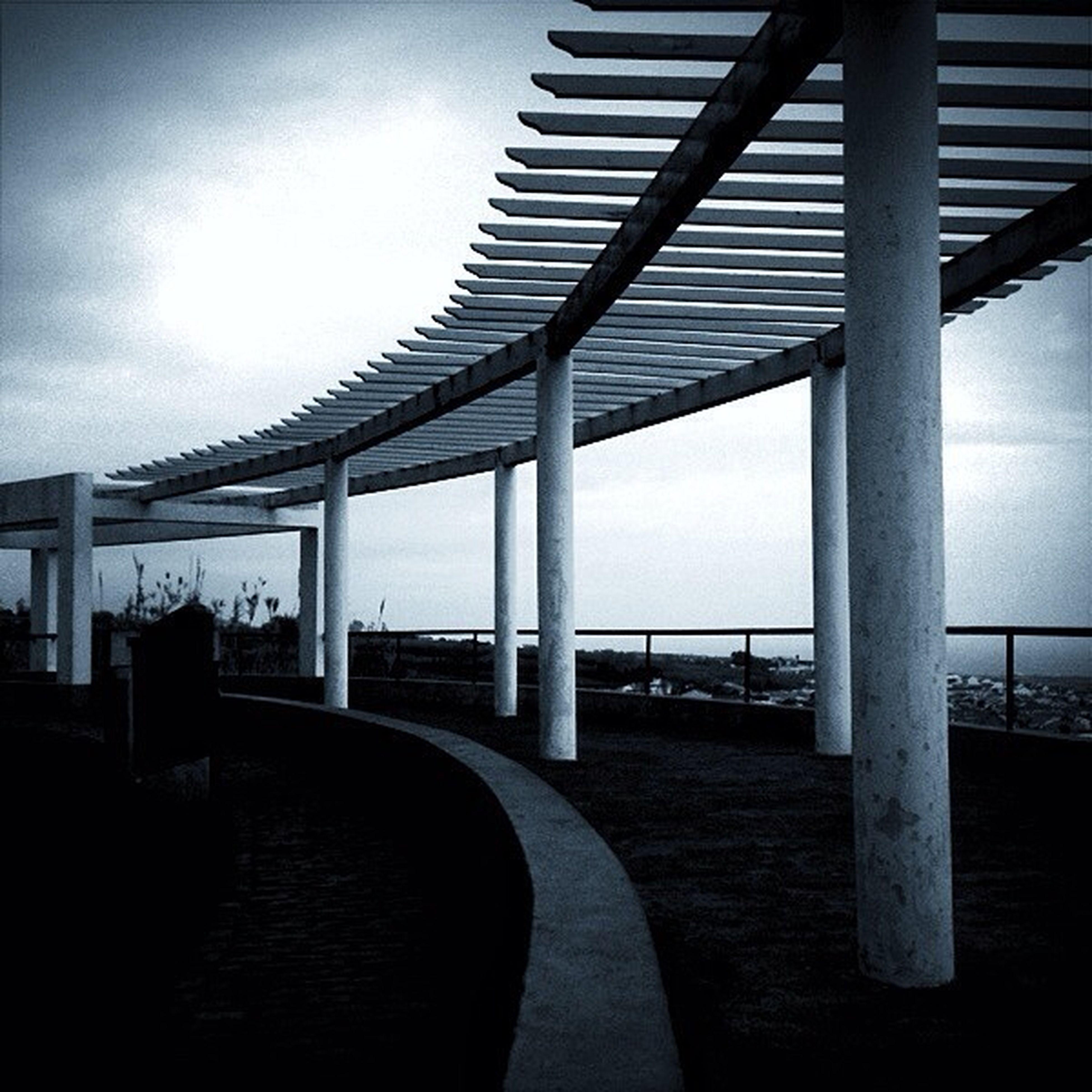 built structure, sky, architecture, sea, cloud - sky, water, railing, pier, indoors, architectural column, silhouette, empty, column, bridge, cloudy, cloud, bridge - man made structure, day, connection, nature