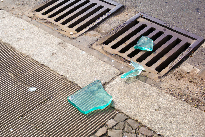 Big piece of broken glass on the street after a riot After Asphalt Broken Glass Concept Day Gutter High Angle View Idea Metal Metal Grate No People Outdoors Riot Road Street Street Photography Streetphotography Trouble Violence Strassenfilm